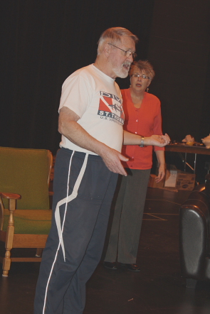 Ed Bayly rehearses a scene from Playgoers of Lethbridge's production of How the Other Half Loves. Photo by Richard Amery