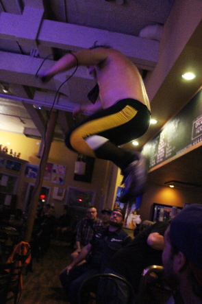 B.A. Johnston jumps off the bar at the Owl Acoustic lounge, Sept. 16. Photo by Richard Amery