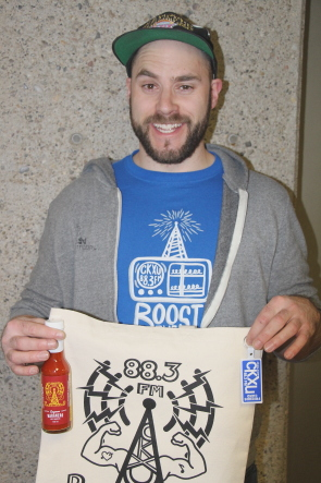 Aaron Trozzo shows some of  the CKXU swag you can get by pledging during Fundrive this week. Photo by Richard Amery