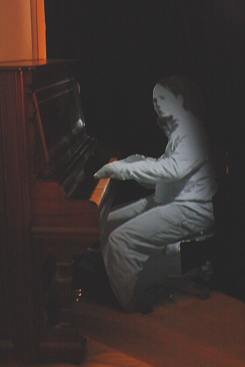Troy Nickle's ghost plays piano. Photo by Richard Amery