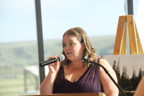 Carie Stock speaks to  the crowd at the Helping Families fundraiser. Photo by Richard amery