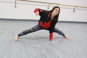 Macy Obara does the splits in preparation for the World Dance Championships in Reisa, Germany. Photo by Richard Amery