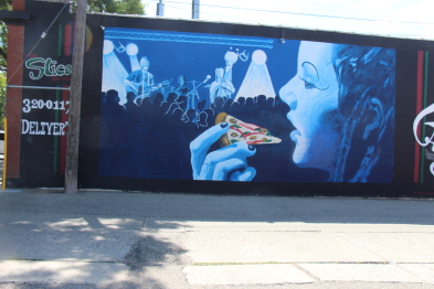 The Slice features one of several beautiful murals downtown. Photo by Richard Amery