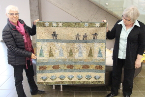 Trudy Walker and Teresa Petriw show one of Walker's quilts to be on display at the Lethbridge Festival of Quilts, June 2 and 3 in the Lethbridge College Val Matteotti gym. Photo by Richard Amery