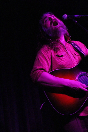 The White Buffalo aka jake Smith entertaining a sold out crowd at the Geomatic Attic. photo by Richard Amery